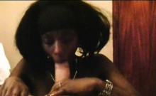 Nasty afro bitch blowing giant white pecker