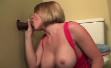 Blonde eats and tugs loaded cock on gloryhole